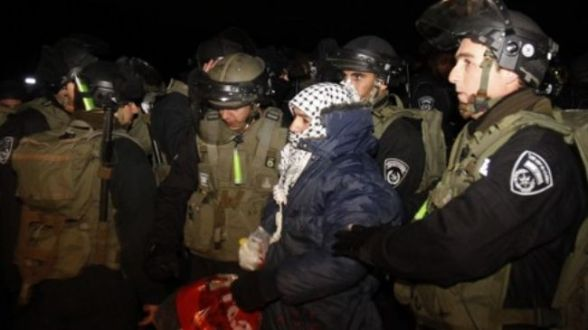 Israeli police forces evict a Palestinian activist from an area known as E1 in the West Bank, January 13, 2012.
