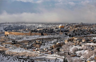 Snow covers the Dome of the Rock in Jerusalem's Old City