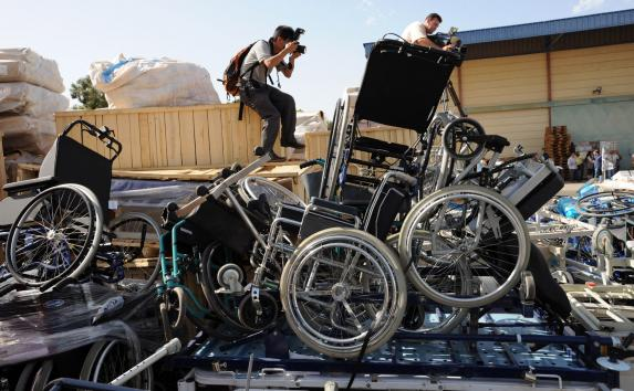 Photographers take photos of wheelchairs unloaded from the flotilla aid ships, now stored at the Zrifin Military Base in Rishon le-Zion, June 7, 2010.  Israel, even blocking the donated wheels to keep Palestinians in need of one moving on in life. UPI/Debbie Hill