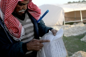 Jan 12, 2013 - Zakaria Abu Jumaa, landowner threatened seizure of Bab al Shams -Gate of the Sun - Photo by Mohamed Farrag