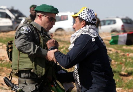 A Palestinian activist is arrested by an Israeli soldier in the Yatta, south of the West Bank city of Hebron on February 9, 2013. Israel's army has forced Palestinian activists to evacuate a West Bank encampment they tried to set up to protest against settlement building, witnesses said Photo via maktoob news