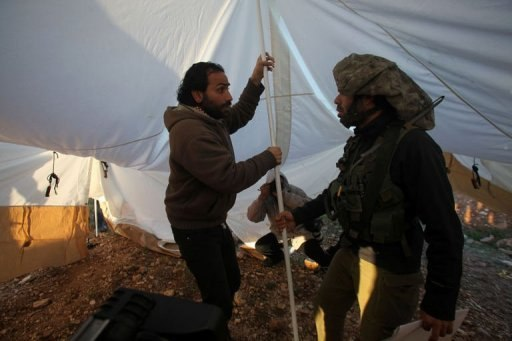 A Palestinian activist is stopped by an Israeli soldier on the outskirts of Hebron, on February 9, 2013 - Photo via Yahoo news