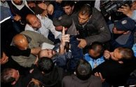 People carry freed Palestinian prisoner Ayman Sharawneh on a stretcher as he gestures upon his arrival to al-Shifa Hospital in Gaza City March 17, 2013. REUTERS/Mohammed Salem