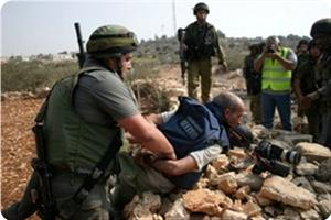 images_News_2013_03_03_journalist-arrested_300_0[1]