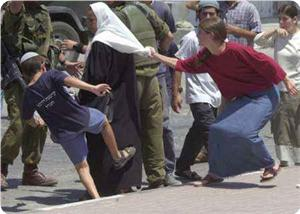 images_News_2013_03_17_israel-settlers-attack-palestine-woman_300_0[1]
