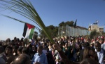A Catholic worshiper holds a palm frond with a Palestinian flag during a Palm Sunday procession on the Mount of Olives in Jerusalem, March 24, 2013. (photo by REUTERS/Ronen Zvulun)   Read more: http://www.al-monitor.com/pulse/originals/2013/03/palestinian-christians-restrictions-easter.html?utm_source=feedburner&utm_medium=feed&utm_campaign=Feed%3A+imeu%2FfromTheMedia+%28IMEU+%3A+News+%26+Analysis+%3A+From+the+Media%29#ixzz2P6OuMR4y