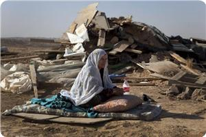 images_News_2013_04_02_displaced-woman_300_0[1]
