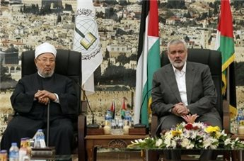 """Hamas Prime Minister Ismail Haniyeh (R) meets with Egyptian Cleric  Yousuf al-Qaradawi (L) in Gaza City on May 9. (AFP/Mohammed Abed GAZA CITY (Ma'an) -- Influential Muslim cleric Yousuf al-Qaradawi on Friday called on the Palestinian resistance to hold onto its arms in a sermon at a Gaza City mosque.  """"I advise all the people of Gaza to be patient and continue to build their country, and continue resistance,"""" the sheikh told worshipers at al-Omari Mosque.  """"We will not give up on the resistance, and we will not give up our arms,"""" he added."""