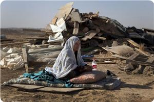 images_News_2013_05_20_bedouin-woman-outside-demolished-home_300_0[1]