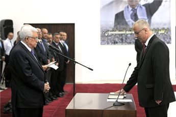Abbas swore Hamdallah into office on June 2.