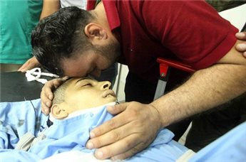 A picture of Muatazz Idreis Sharawnah, 19, in Hebron's public   hospital. Sharawnah died of injuries sustained after being hit by an   Israeli military vehicle during clashes in the West Bank city of Dura,   Hebron district on 2 July 2013. (MaanImages)