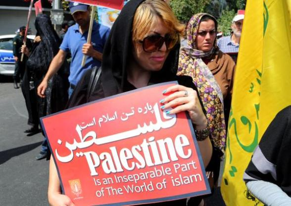 Iranians carry placards during an anti-Israeli rally to mark al-Quds Day (Jerusalem Day) on the last Friday in the Muslim's Holy month of Ramadan, in Tehran, Iran, 02 August 2013. Al-Quds Day is celebrated in Iran since 1979 in a move to express support for the Palestinian people and their resistance against Israeli occupation and was attended by thousands of Iranians on 02 August 2013 with anti-Israeli demonstrations throughout the country. Credit: EPA
