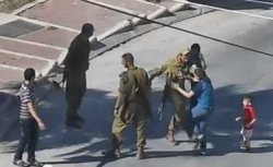 soldier kids kick boy israel palestine