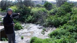 images_News_2013_09_04_burqin-flooded-sewage-ariel_300_0[1]