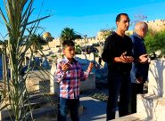 Jerusalem - Citizens visiting the graves of their relatives on the Eid al-Adha Photo by Afif Emira - WAFA