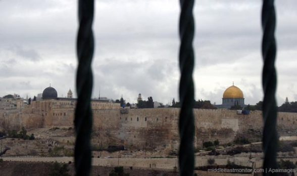 Al-Aqsa Mosque (black dome) and the Dome of the Rock