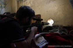 free-syrian-army-sniper-scoping-from-a-hole-aleppo