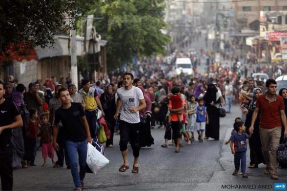 Civilians flee in en masses to escape imminent Death by terrorist Israel via @YousefAljamal