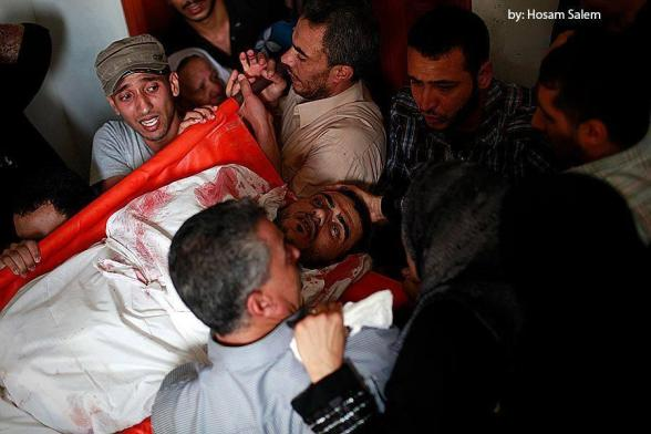 "Funeral martyr journalist ""Khaled Hamad"" attacked by Israeli Forces at #Shijaia via @saidshouib"