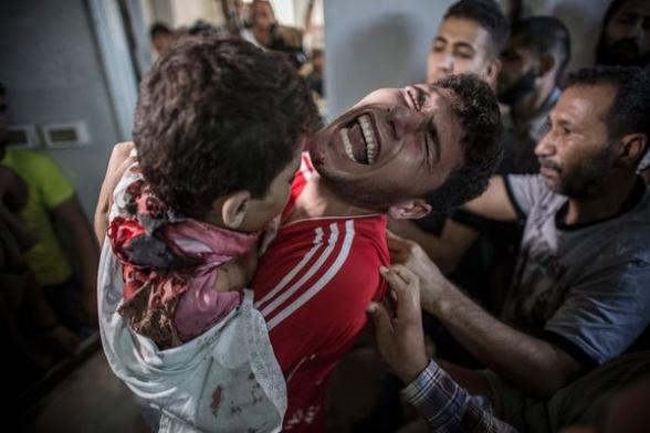 Palestinians mourn four children killed on Gaza City beach http://nbcnews.to/WhQ7k0  Image by @OliverWeiken