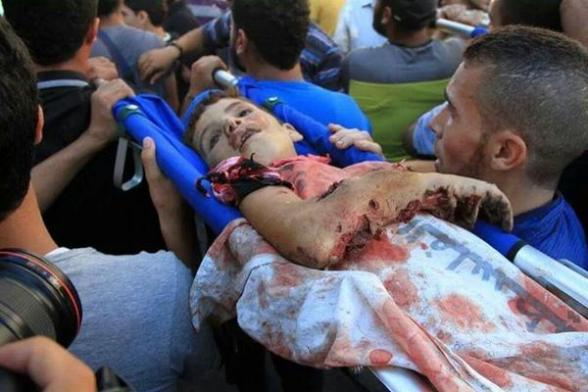 A child martyr on his way to be buried after being murdered by Israel drones at Gaza port - Photo via @HanaSiliman