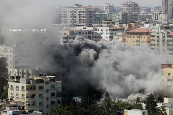 Columns of smoke rising due to the Israeli air strikes on #Gaza City - Photo by Omar el Qattaa
