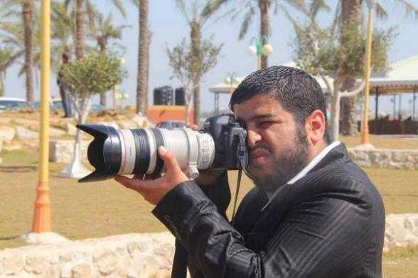 Photo journalist Ezzat Duhair, killed with 4 members of his family