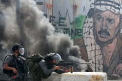 Israeli soldiers keep their position during clashes with Palestinian stone throwers at the Qalandia checkpoint between the West Bank city of Ramallah and Jerusalem on September 21, 2011. AFP PHOTO/AHMAD GHARABLI (Photo credit should read AHMAD GHARABLI/AFP/Getty Images) - See more at: http://mondoweiss.net/2014/08/operation-protective-palestinians.html?utm_source=Mondoweiss+List&utm_campaign=2a816439f0-RSS_EMAIL_CAMPAIGN&utm_medium=email&utm_term=0_b86bace129-2a816439f0-398418937#sthash.xWw5R055.dpuf