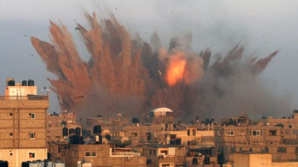 Smoke and debris rise after an Israeli strike on the Gaza Strip. (File photo)