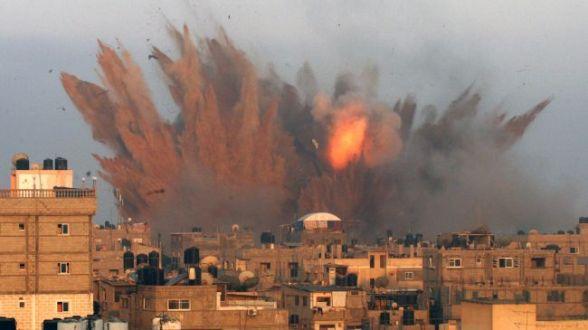 Smoke and debris rise after an Israeli strike on the Gaza Strip. (File photo)
