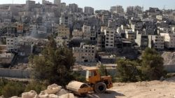 An Israeli bulldozer sits at a construction site in East al-Quds (Jerusalem). (file photo)